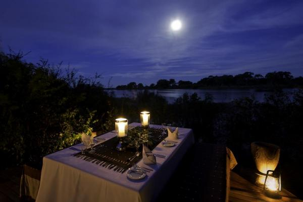 Enjoy a moonlight dinner on the water.