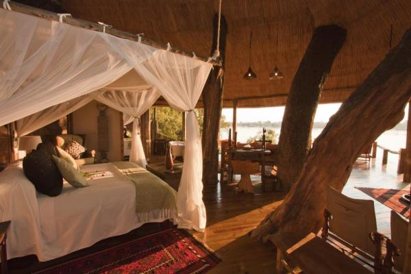Relax in Tongabezi Lodge's spacious and comfortable rooms.