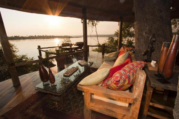 Relax on the patio and enjoy the view at the Tongabezi Lodge