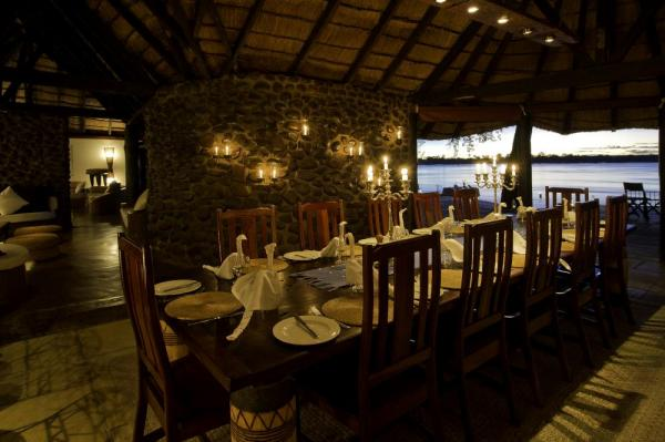 A dining room with a view at the Tongabezi Lodge
