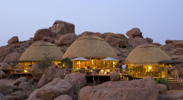 The unique huts of Camp Kipwe at night