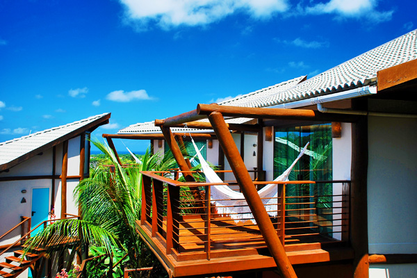 Relax on your private deck at Pousada Teju Acu