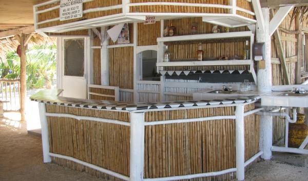 After a day of adventure, enjoy the open-air bar at Billy Hawk Caye