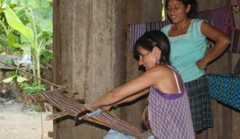 Taking a turn at weaving during the Lodge at Big Falls demonstration