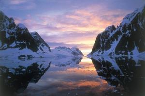 Enjoy a spectacular sunset on the Lemaire Channel during your Antarctica expedition cruise