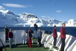 Taking in the view of the Antarctic mountains from the deck of Polar Pioneer