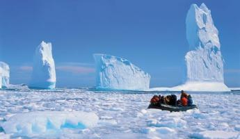 Zodiac cruising among the pack ice and icebergs of the peninsula