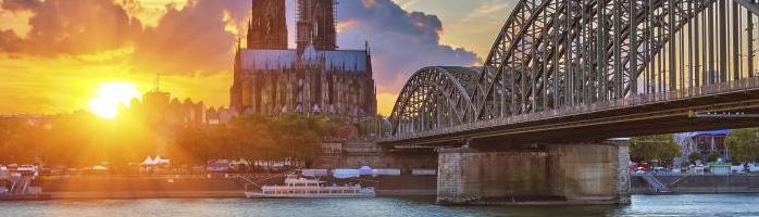 A cathedral at sunset from the Rhine in Cologne