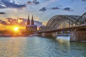A cathedral at sunset from the Rhine