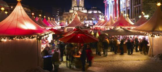 Lights brighten the evening at this bustling Christmas Market
