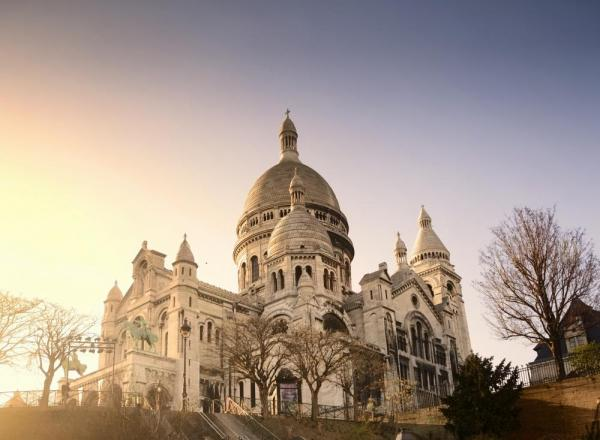Visit the unique Sacre Coeur Basilica while touring through Paris