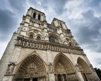 The gothic Notre-Dame Cathedral towers over the streets of Paris