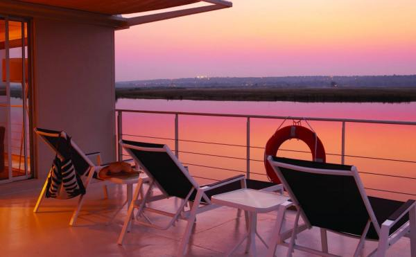 Relax on the sun deck of the Zambezi Queen.