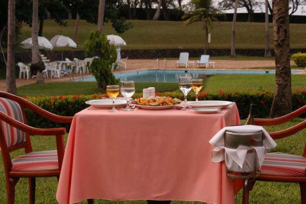 Enjoy fine dining by the pool at Pestana Sao Luis