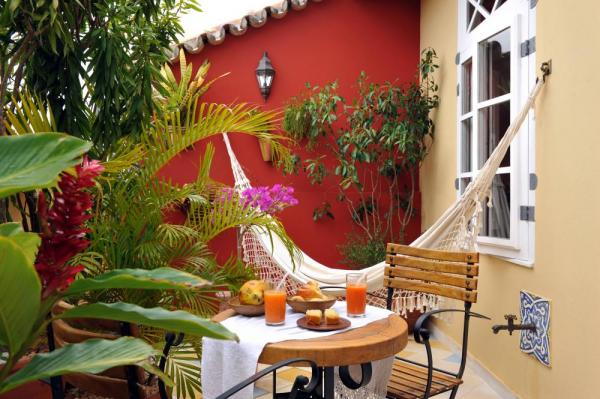Relax in your hammock at the charming Pousada Villa Bahia