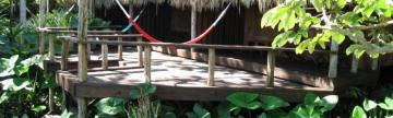 Relax on the deck at Lamanai Outpost Lodge