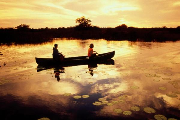 Canoers enjoy sunset at Lamanai Outpost Lodge