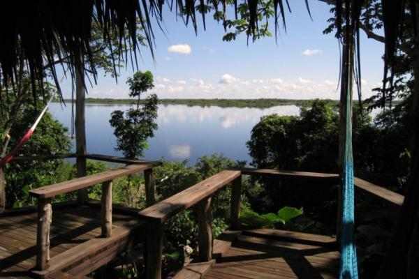 Enjoy the view from the deck at Lamanai Outpost Lodge