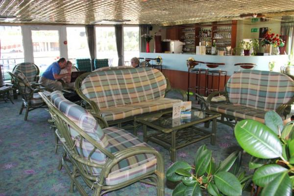 Relax in the library on board La Belle de Cadix