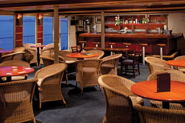 Enjoy a drink at the bar aboard the Safari Voyager.