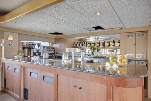 Enjoy a drink at the bar aboard the Safari Endeavour.