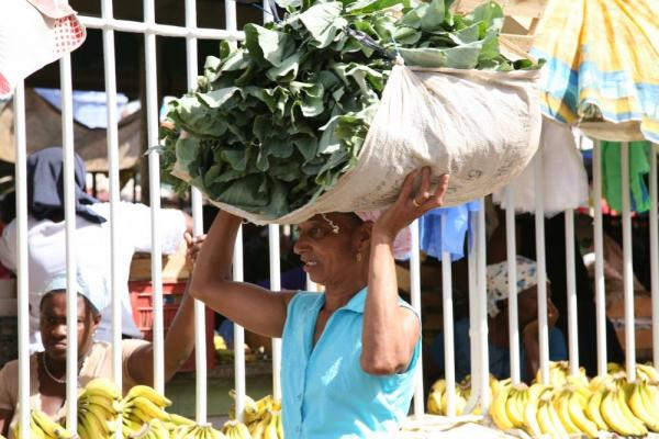 Local carrying food on her head.