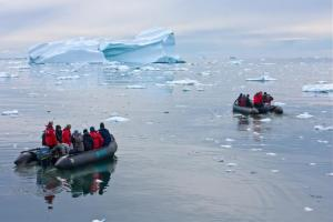 Travelers exploring the arctic with zodiacs.