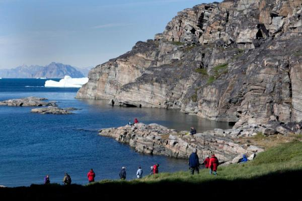 Travelers on the shores of Greenland.