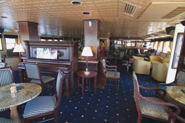 Relax in the Grand Salon aboard the SS Legacy.