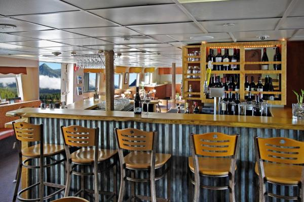 Enjoy a drink at the bar aboard the Wilderness Adventurer.