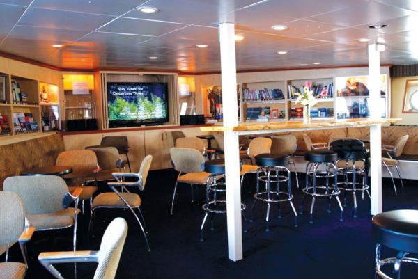 Relax in the bar aboard the Wilderness Discoverer.