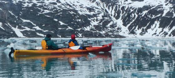 Kayaking among beautiful Alaskan mountains