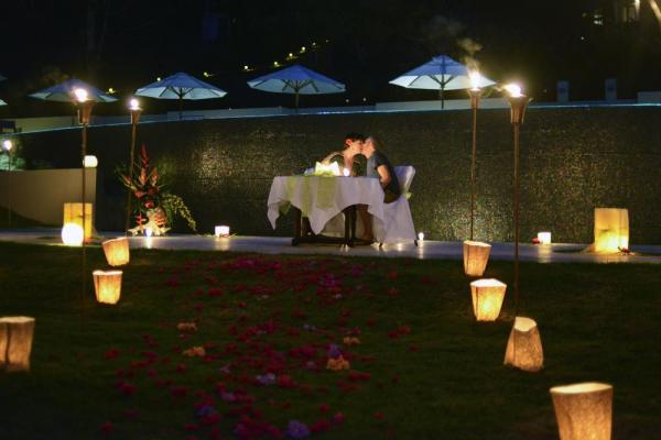 A romantic moon-lit dinner for two at the Lodge at Chaa Creek