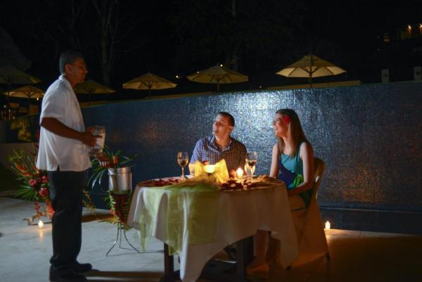 A romantic outdoor dinner for two at the Lodge at Chaa Creek