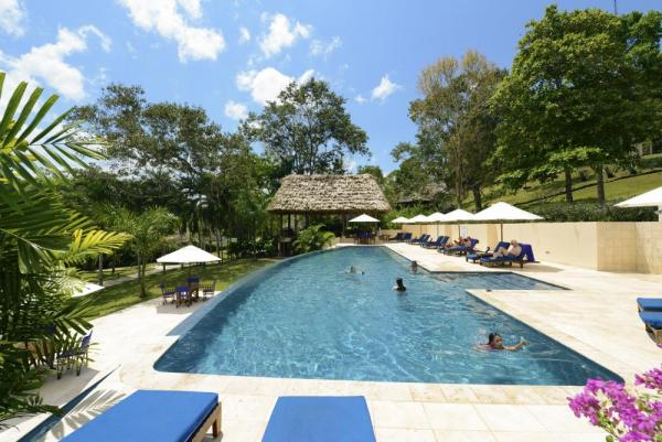 Relax in the pool at the Lodge at Chaa Creek