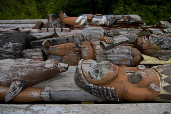 A pile of old totem poles.