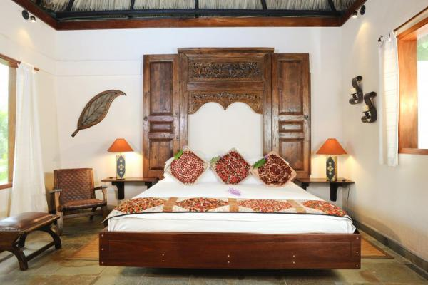 The master bedroom in one of the Lodge at Chaa Creek's private cottages