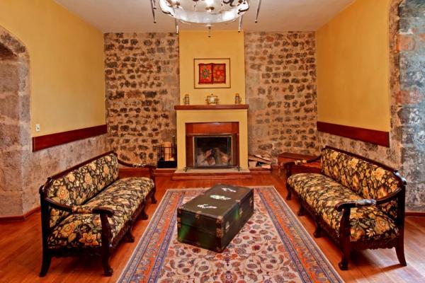 Relax by the fire in the La Cienega sitting room
