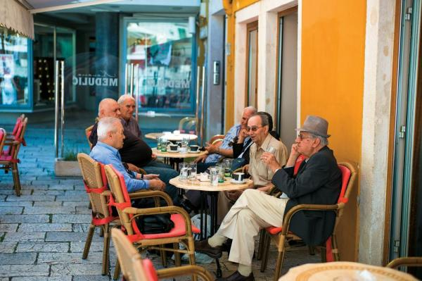 Locals sitting at a cafe in Croatia.