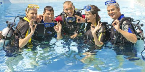 Travelers getting ready to scuba dive.