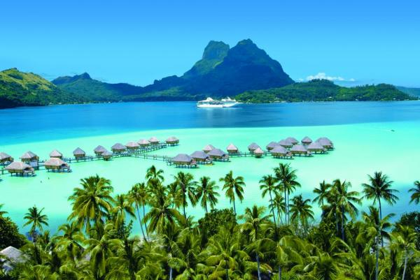 Paul Gauguin sits outside Bora Bora.