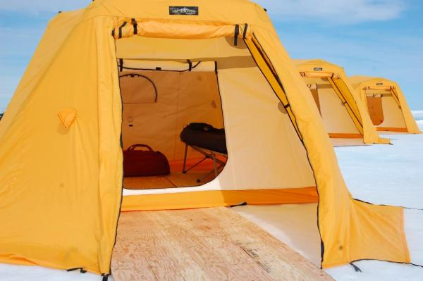 Your warm and comfortable tent at Arctic Kingdom's Tented Safari Camp