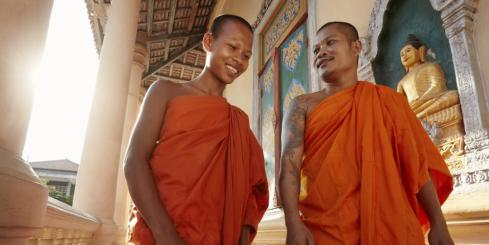 Monks conversing in a Buddist temple