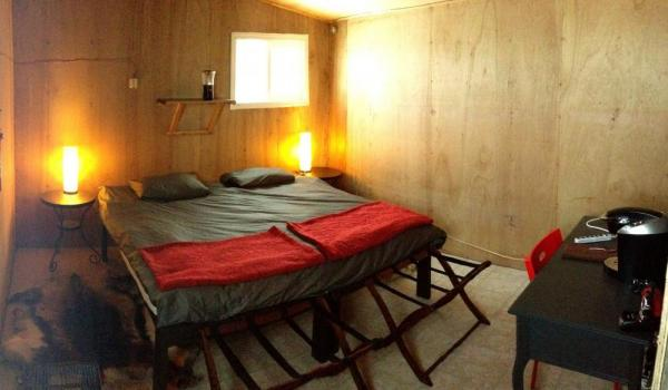 Your guest room at Arctic Kingdom's Polar Bear Cabins is warm and comfortable