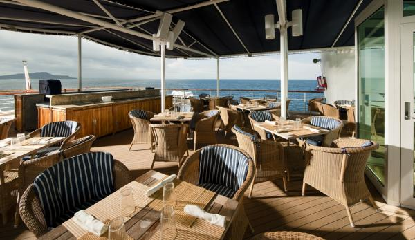 Enjoy a meal on the sun deck of the Isabela II.