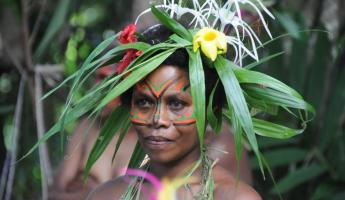Local of Melanesia wears a traditional headdress.