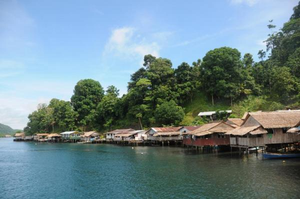 Houses line the coast of the Melanesia islands.