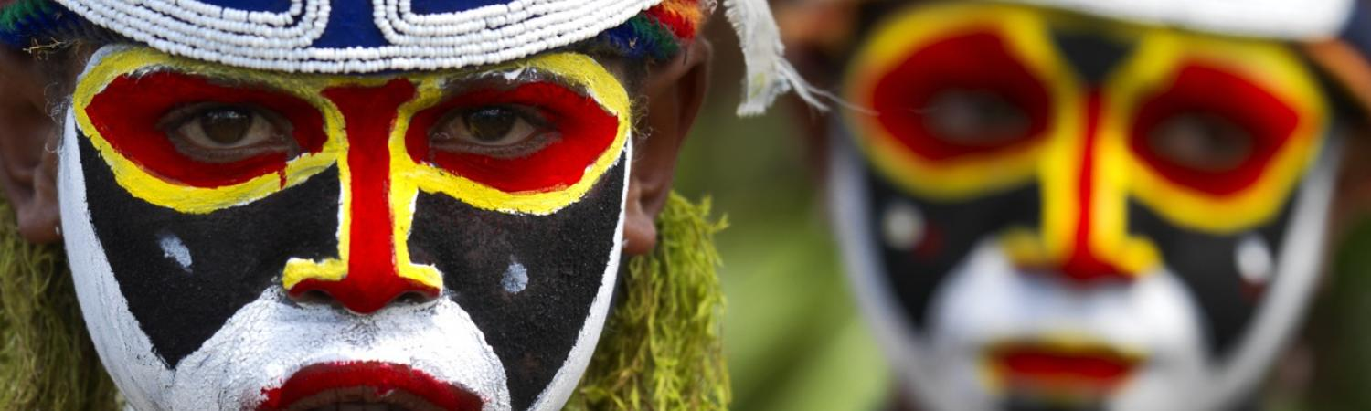Locals of Papua New Guinea dressed in traditional headdress.