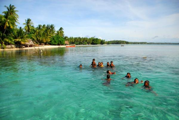 Swimming in the crystal blue waters of Papua New Guinea.