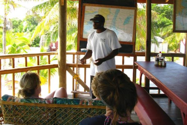 Visitors participate in an educational talk at Glover's Reef Field Camp